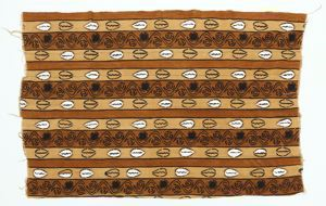 Image of Bamana cloth with horizontal rows of cowrie shells against a brown and mustard ground