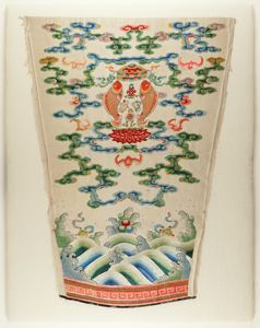 Image of Embroidered sleeve fragment waves, clouds, bats, and Buddhist symbolism