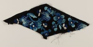 Image of Fragment of tape for edging garments with begonias and butterfly