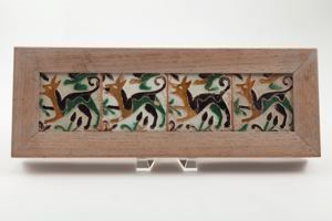 Image of Four tiles with jumping deer and bird motif