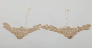 Image of Cuffs in elaborate ecru lace with floral patterns