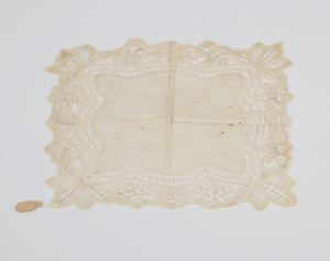 Image of Handkerchief with shaped lace border of floral designs formed of braid
