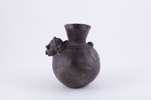 Image of Black vessel with human head