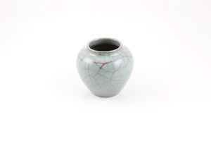 Image of Celadon vase with dark crackling and red tinting