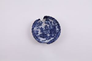 Image of Blue and white Imari ware bowl with scenes of houses and outdoors, fluted edge
