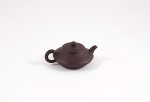 Image of Small brown round teapot with raised rings