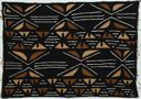 Image of Bamana mud cloth with black background and geometric designs in brown and white