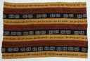 Image of Bongola cloth with strips of dyed brown, black, and red material