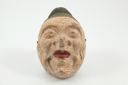 Image of Mask, human face with green hat with gilt band