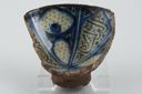 Image of Deep bowl, possibly Persian with radiating blue bands, black calligraphic design
