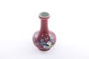 Image of Oxblood vase with Buddha's finger, peach, pomegranate, and prunus blossom decorations