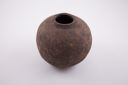 Image of Round vase with narrow upturned lip and rough gray matte surface