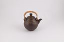 Image of Brown teapot with bamboo handle