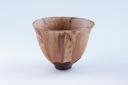 Image of Small conical bowl, mustard brown with dark oil streak striations
