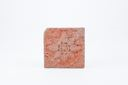 Image of Square ceramic tile with red flower against orange background